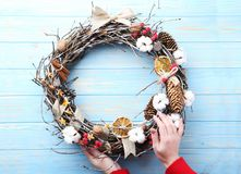 Christmas wreath. On blue wooden table royalty free stock photo