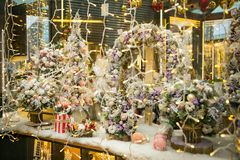 Christmas wreath and bouquets in the shop window. Christmas wreath and bouquets in a shop window Royalty Free Stock Image