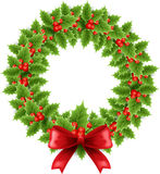 Christmas wreath with bow. Christmas holly wreath with red bow Royalty Free Stock Photo