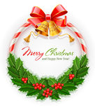 Christmas wreath with bow and gold bells Stock Photos