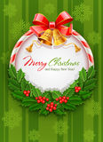 Christmas wreath with bow and gold bells Royalty Free Stock Photo