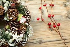 Christmas wreath and branch with red fruits Stock Photo