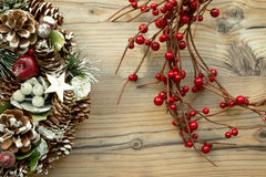 Christmas wreath and branch with red fruits Royalty Free Stock Images