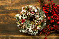 Christmas wreath and branch with red fruits Royalty Free Stock Image