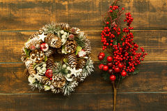 Christmas wreath and branch with red fruits Stock Image