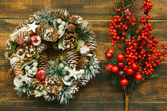 Christmas wreath and branch with red fruits Royalty Free Stock Photos