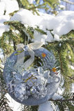 Christmas wreath on the branches of spruce covered with snow Stock Photography