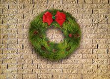 Christmas Wreath on a Brick Wall stock images