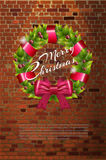 Christmas wreath on brick wall. Royalty Free Stock Photos