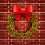 Christmas wreath on the brick wall Royalty Free Stock Photos