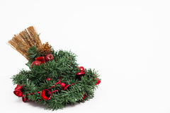 Christmas wreath and a broom decorated Stock Images