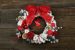 Christmas wreath on the. Brown wooden background Stock Photography