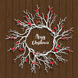 Christmas wreath on brown wooden background, illustration. Christmas wreath created from white branches with red berries lying on brown wooden background, vector vector illustration