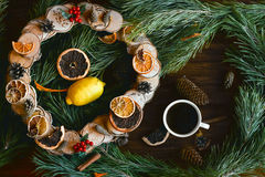 Christmas wreath on brown wooden table top view Royalty Free Stock Images