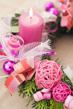 Christmas wreath with burning candles Stock Photos