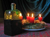 A Christmas wreath with burning candles and an ant Stock Image