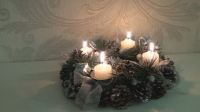 Christmas wreath with burning candles stock footage