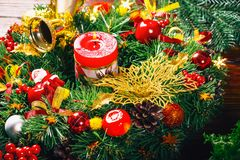 Christmas wreath with burning red candles on wooden background Stock Images