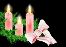 Christmas wreath and candle Stock Images