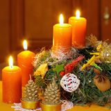 Christmas wreath with candles Stock Photos