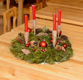 Christmas wreath with candles. On the wooden table Royalty Free Stock Images