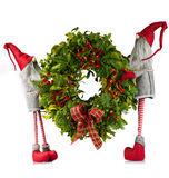 Christmas wreath carried by elves