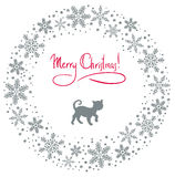 Christmas wreath with cat. Christmas background with cat and snowflakes Stock Photography