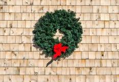 Christmas wreath on cedar shingle wall Stock Photos