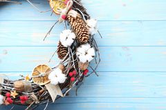 Christmas wreath. On blue wooden table stock photography