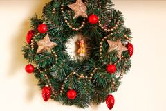 Christmas wreath. On the wall and baubles Royalty Free Stock Images