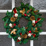 Christmas wreath. Close up of festive Christmas wreath hanging on a door royalty free stock images
