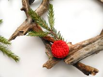 Christmas wreath closeup. Tree and fir branches. Red flower. White background. Minimalistic design