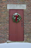 Christmas Wreath on Colonial Schoolhouse Door Stock Images