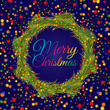 Christmas wreath with colorful confetti on dark blue background. Christmas wreath with colorful confetti of different sizes on dark blue background Stock Photo