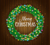 Christmas wreath, colourful glowing garland, lights. Wood texture. Greeting card Royalty Free Stock Images