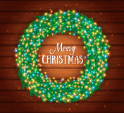 Christmas wreath, colourful glowing garland, lights. Wood texture. Greeting cards Stock Photo
