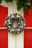 Christmas wreath of cones and berries on the door, New Year`s de Stock Photos