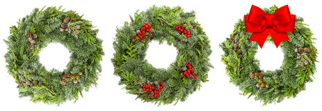 Christmas wreath with cones red berries ribbon bow Royalty Free Stock Photos