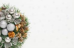 Christmas wreath of cones, silver balls and fir branches on white background. New year decorations, top view, copy space royalty free stock photos