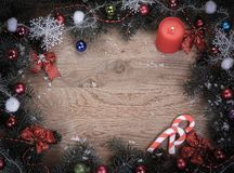 Christmas wreath with a congratulatory inscription on a wooden stock images