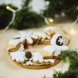 Christmas wreath with cookies. New Year's gift of gingerbread. Christmas tree decorated with lights royalty free stock photo