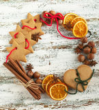 Christmas wreath with cookies and spices. Christmas wreath with cookies, nuts and spices royalty free stock photos