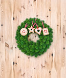 Christmas wreath with cookies on wooden background Stock Photography