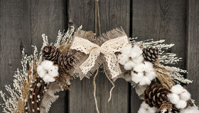 Christmas wreath with cotton. Christmas wreath with pine cones and cotton Royalty Free Stock Images