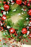 Christmas wreath. With cranberry, spruce and red apples Royalty Free Stock Images
