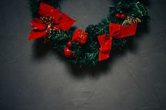 Christmas wreath on a dark textured background, copy space royalty free stock images