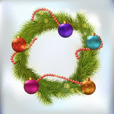 Christmas wreath decorated. With balls and chaplet Royalty Free Stock Images