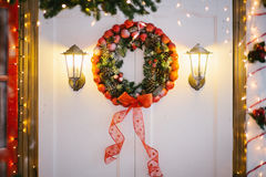 Christmas wreath decorated with baubles and pine cones Stock Photos