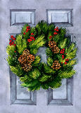 Christmas wreath decorated with cone and berries Stock Photos