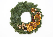 Christmas wreath decorated with oranges isolated on white backgr Royalty Free Stock Photo